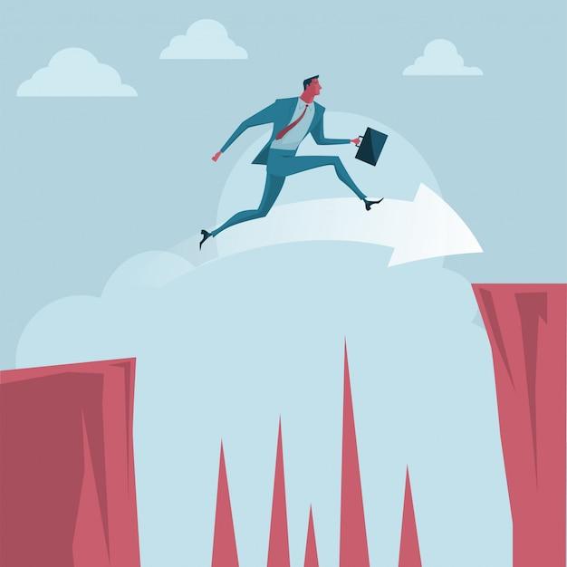 Empresario saltando por encima de los acantilados.