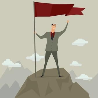 Empresario sosteniendo la bandera en la cima de la montaña