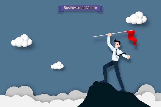 Empresario sosteniendo una bandera roja en la cima de la montaña