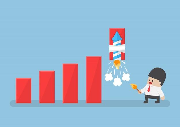 El empresario usa fuegos artificiales de cohetes para aumentar el gráfico de ganancias