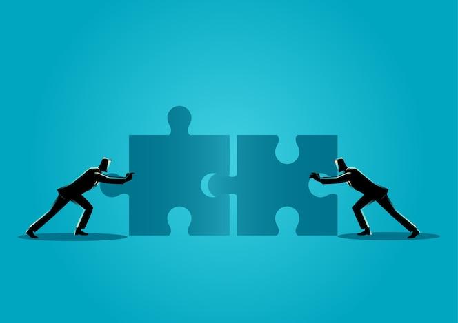 Empresarios empujando dos piezas de rompecabezas