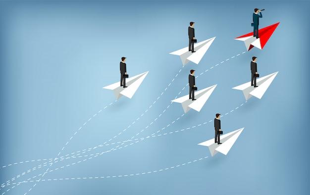 Empresarios de pie en avión de papel