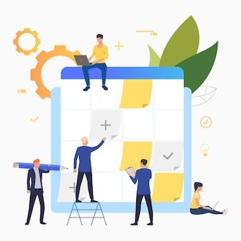 Empresarios planificando y trabajando con panel de tareas