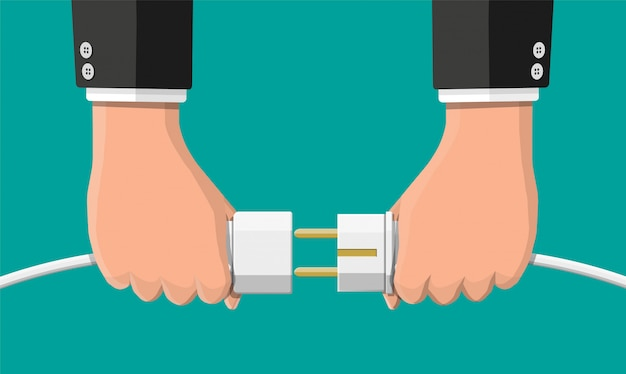Los empresarios sostienen el enchufe y la toma de corriente en la mano.