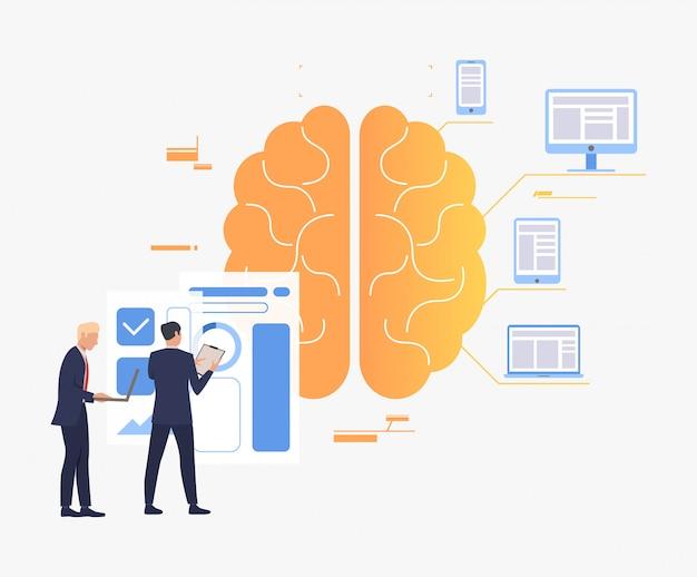 Empresarios trabajando, cerebro, gráficos y dispositivos digitales.