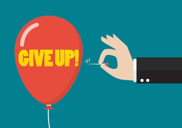 Empujar la aguja con la mano para reventar el globo de la palabra renunciar