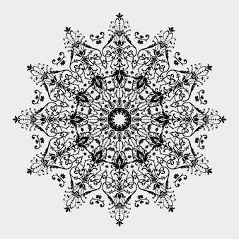 Encaje redondo ornamental con elementos de damasco y arabescos.