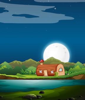 Encantada casa de madera en la noche.