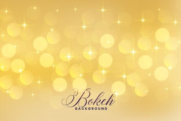 Encantadoras luces bokeh en color dorado con fondo de estrellas