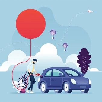 Energía renovable hombre de negocios alimentando un automóvil utilizando la energía del sol