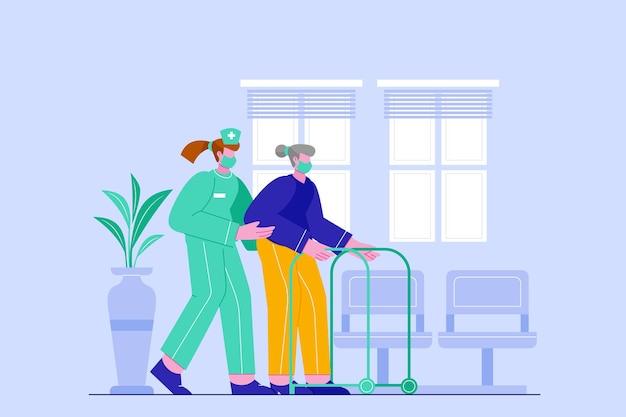 Enfermera ayudando a un anciano paciente en el hospital