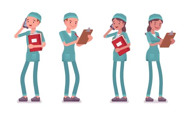 Enfermera masculina y femenina de pie