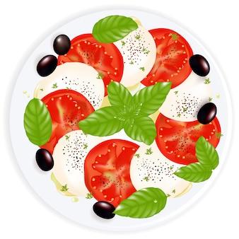 Ensalada caprese con mozzarella, albahaca, aceitunas negras y aceite de oliva