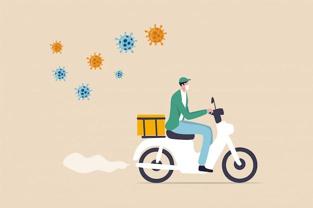 Entrega de alimentos, entrega de alimentos en bicicleta, productos o comestibles en el brote de coronavirus, distanciamiento social de las personas que se quedan en casa y ordenan alimentos en línea con el servicio de entrega, el hombre que viaja en bicicleta entrega alimentos, el virus covid-19.