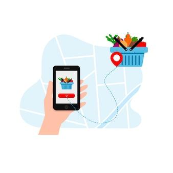 Entrega de alimentos de verduras a través de la aplicación en el teléfono.
