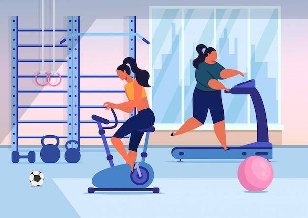 Entrenamiento de chicas en gimnasio plano