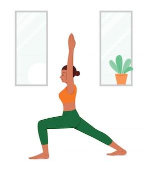 Entrenamiento de mujer por yoga en casa.