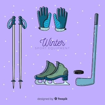 Equipamiento de deporte de invierno dibujado a mano