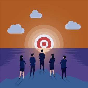 El equipo del hombre de negocios ve la blanco en el horizonte.