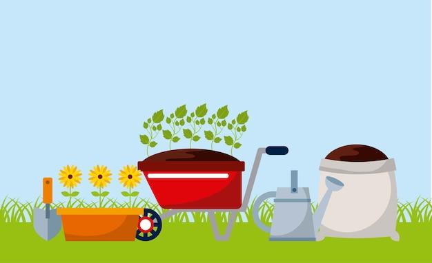 Equipo de jardinería con flores y tierra