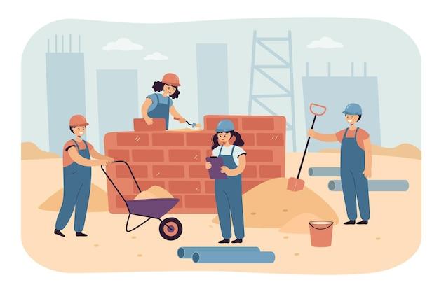 Equipo de niños felices trabajando como constructores.