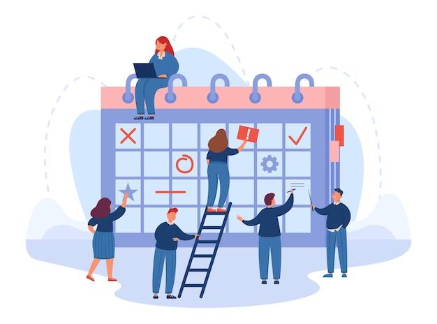 Equipo de trabajadores de oficina que planifican negocios en un calendario gigante