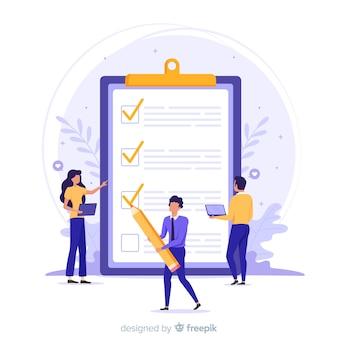 Equipo de trabajo revisando una lista de tareas gigante