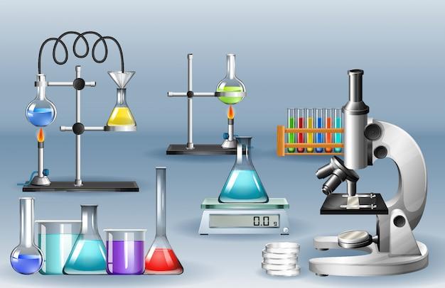 Equipos de laboratorio con vasos de precipitados y microscopio.