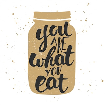 Eres lo que comes, caligrafía moderna con pincel de tinta.
