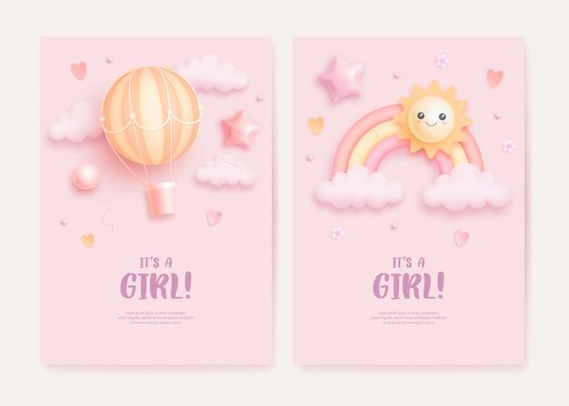 Es una tarjeta de felicitación de niña para baby shower con globo aerostático y arco iris.