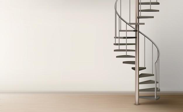 Escalera de caracol en diseño interior de la casa vacía