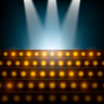 Escaleras con focos al escenario iluminado.