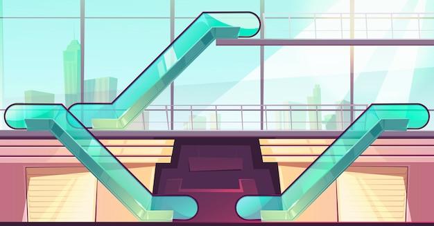 Escaleras mecánicas en el centro comercial. ascensores con barandas de vidrio.