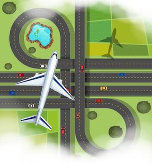 Escena aérea con avión volando sobre las carreteras.