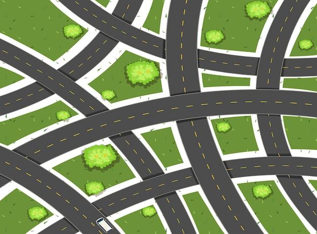 Escena aérea con carreteras y campo.