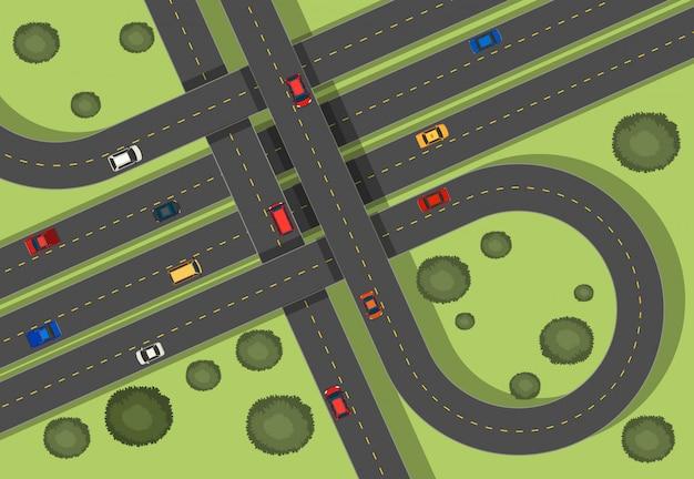 Escena aérea con carreteras y coches.