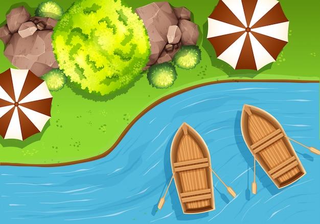 Escena aérea en la naturaleza con barcos en un lago
