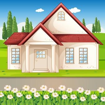Escena al aire libre con una casa y un campo de flores.