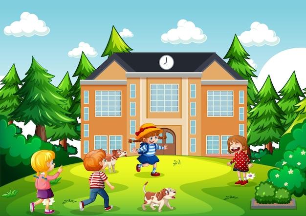 Escena al aire libre con muchos niños jugando frente al edificio de la escuela.