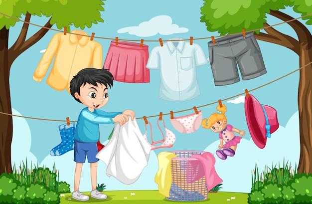 Escena al aire libre con un niño colgando ropa en tendederos.