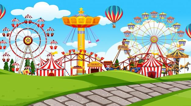 Escena al aire libre con parque de atracciones