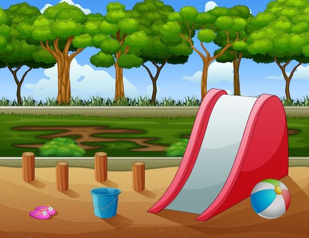 Una escena al aire libre con tobogán y juguetes.