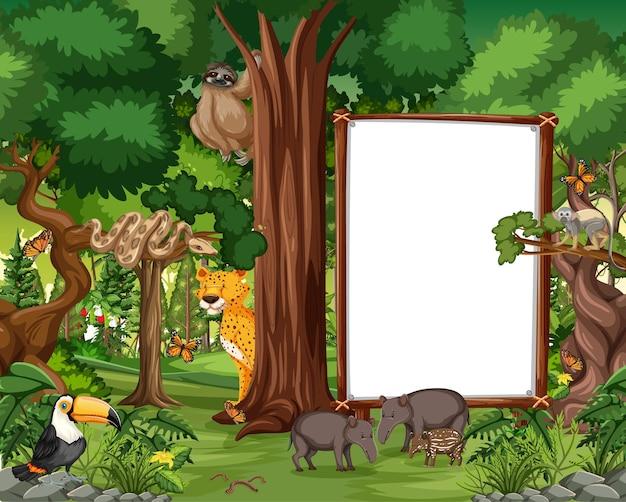 Escena del bosque con marco vacío y muchos animales salvajes.