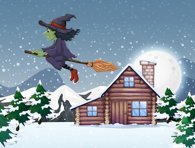 Escena con bruja verde volando en invierno