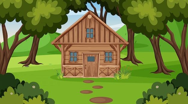Escena con cabaña de madera en el campo