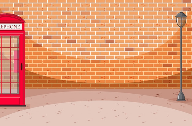 Escena de calle de pared de ladrillo con caja de teléfono