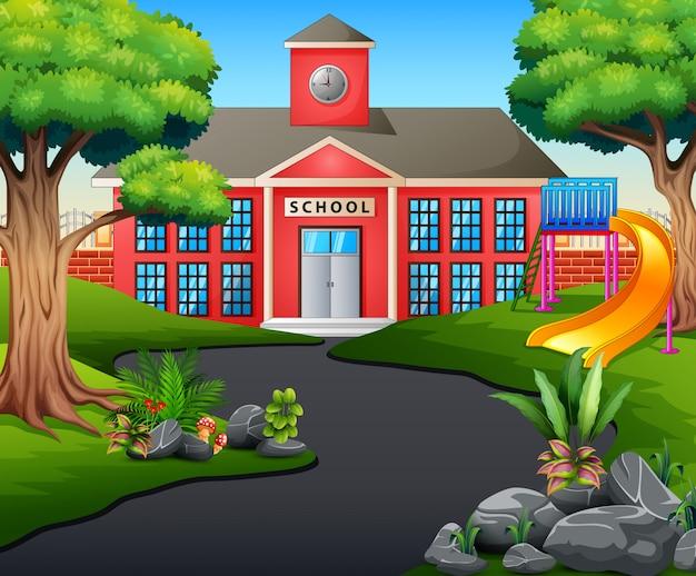 Una escena del camino hacia el edificio de la escuela con tobogán
