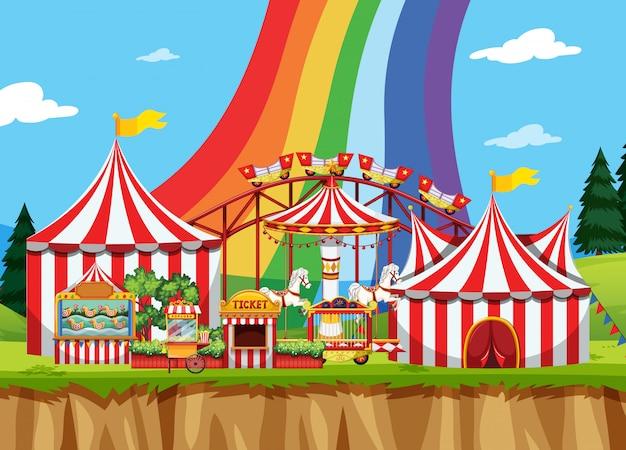 Escena de circo con arcoiris en el cielo