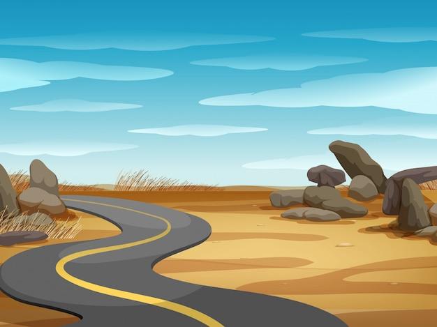 Escena con camino vacío en tierra del desierto
