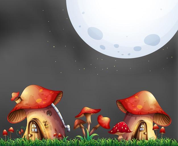 Escena con dos casas de hongos en la noche